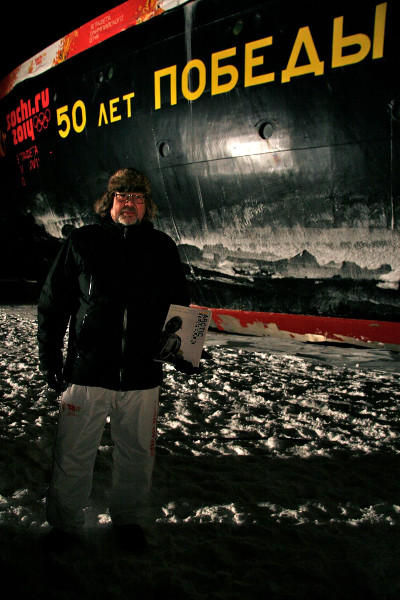 Dr. Lassi Heininen carrying a copy of the Arctic Yearbook 2013 at the North Pole